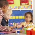 Group Of Elementary Age Schoolchildren In Art Class